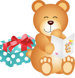 Teddy bear with birthday card and gift Stock Photos