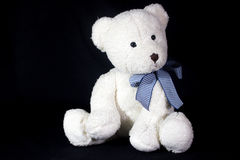 Teddy bear in a black background Royalty Free Stock Photos