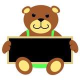 Teddy Bear With Blackboard. Cute brown teddy bear in light green jumpsuit sitting and holding chalkboard Royalty Free Illustration