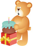 Teddy bear blowing out candle Stock Photography