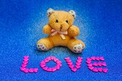 Teddy bear on blue background. Stock Images