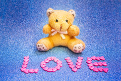Teddy bear on blue background. Stock Image