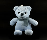 TEDDY BEAR blue color with scarf on black background Royalty Free Stock Photo