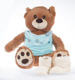 Teddy bear with blue shirt and ribbon, isolated. Teddy bear with blue shirt and ribbon and shoes, isolated on white background Stock Photos