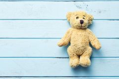Teddy bear on blue table. The teddy bear on blue table Royalty Free Stock Photo