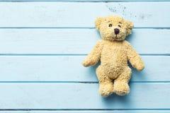 Teddy bear on blue table Royalty Free Stock Photo