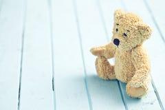 Teddy bear on blue table Stock Photos