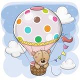 Teddy Bear bonito está voando em um balão de ar quente ilustração do vetor