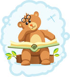 Teddy bear book. Pensive Bear sits on the stump with a book Stock Photo
