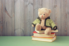 Teddy  bear and books on the table. Stock Images