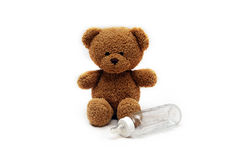 Teddy bear and bottle stock images