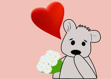 Teddy bear with a bouquet Stock Image