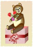 Teddy bear with bouquet of roses sitting on a gift box. Cute birthday card for child. Royalty Free Stock Photos