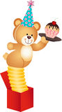 Teddy bear in the box with surprise cake birthday Stock Image