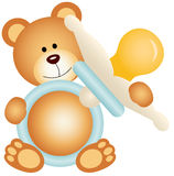 Teddy bear boy holding blue baby pacifier Stock Photo