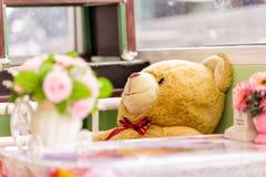 Teddy Bear brown color sitting on the chair Stock Photos