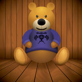 Teddy bear brown stuffed toy print on chest wooden background.  Stock Photography