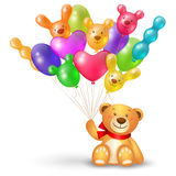 Teddy bear with a bunch of balloons
