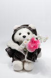 Teddy bear with a bunch of flowers. Isolated on the white stock photo