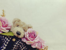 Teddy bear with bunch of flowers copy space background made with vintage filter color Stock Photos