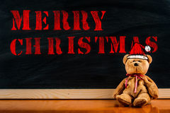 Teddy bear with callout symbol and message `merry christmas` Stock Image