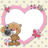 Teddy Bear with a camera and a heart frame Stock Image