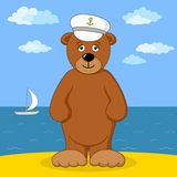 Teddy bear captain on sea coast Royalty Free Stock Images