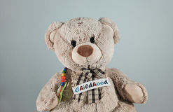Teddy bear with the caption `Childhood` royalty free stock photo