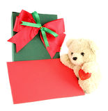 Teddy bear and card and gift. On white background Stock Photography