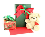 Teddy bear and card and gift. On white background Royalty Free Stock Photo