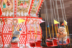 Teddy bear and carousel royalty free stock photo