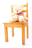Teddy bear on chair Stock Images