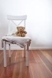 Teddy bear on chair. With blanket stock photos