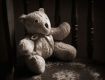 Teddy Bear in Chair, Sepia Stock Image