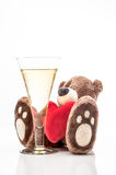 Teddy bear and champagne Stock Images