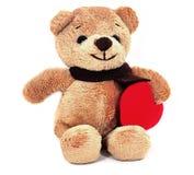 Teddy Bear che tiene un cuore. Fotografia Stock