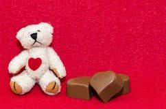 Teddy bear and chocolates stock photo