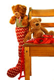 Teddy bear Christmas. Teddy bears placed on an old school chair waiting for Christmas stock photo