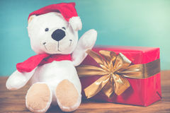 Teddy bear in Christmas background in retro style Stock Images