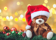 Teddy Bear in Christmas with Ball and Gift Box in Blur Backgroun Stock Photography