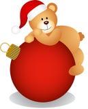 Teddy bear on Christmas ball Stock Photos