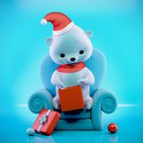 Teddy bear with Christmas box sitting on a sofa, clipping path Stock Photos