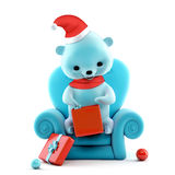 Teddy bear with Christmas box sitting on a sofa, clipping path Royalty Free Stock Image