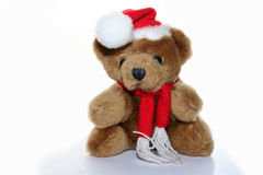 Teddy bear in christmas cap Stock Images