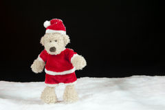 Teddy bear in christmas clothes in the snow Royalty Free Stock Photo