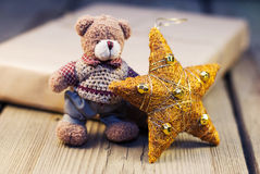 Teddy Bear with Christmas decoration and wrapped gift stock photo