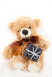 Teddy-bear with christmas gift Stock Photography