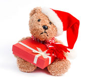 Teddy bear with Christmas gift Royalty Free Stock Image