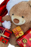 Teddy bear with christmas gifts Stock Photos