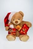 Teddy bear with christmas gifts Stock Photos
